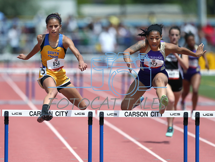 Sunrise Mountain's Brittany Veal, right, wins the Division IA girls 300-meter hurdles with a time of 44.55, just ahead of South Lake Tahoe's Maya Brosch at 44.59 during the NIAA state track championships at Carson High, in Carson City, Nev., on Saturday, May 24, 2014. (Las Vegas Review-Journal, Cathleen Allison)