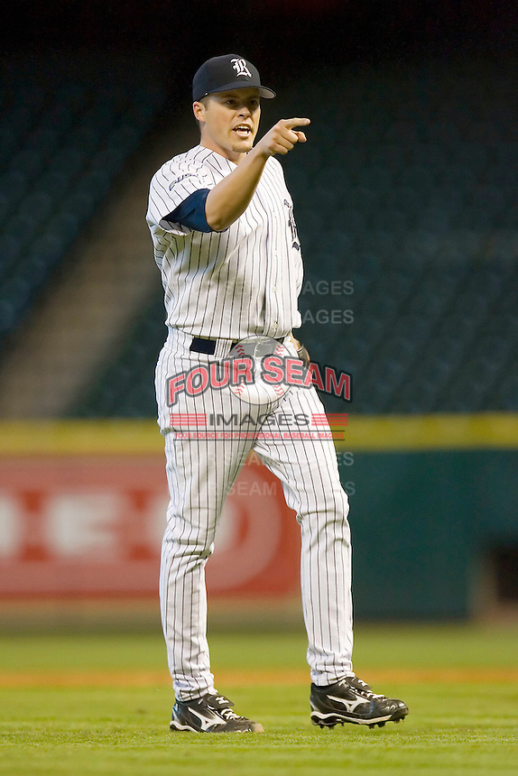 Relief pitcher Jordan Rogers #31 of the Rice Owls reacts after getting the final out versus the Baylor Bears in the 2009 Houston College Classic at Minute Maid Park March 1, 2009 in Houston, TX.  The Owls defeated the Bears 8-3. (Photo by Brian Westerholt / Four Seam Images)