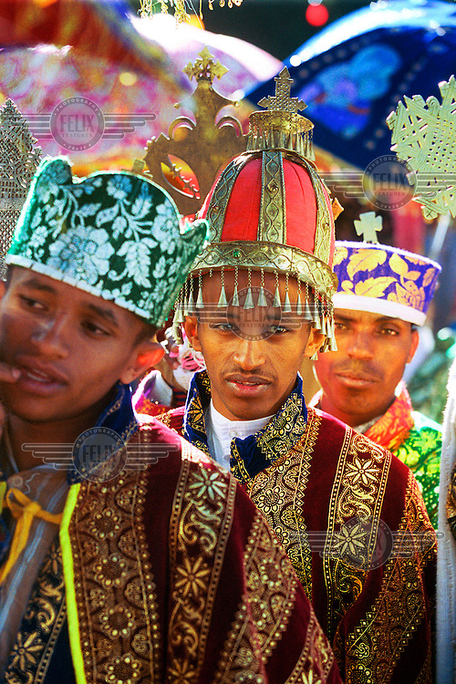 Colourful costumes in the procession. During Timkat, 'epiphany' for the Ethiopian Orthodox church, thousands of christians make the pilgrimage to Gondar. The church tabots (replicas of the ark of the convenant) are taken to a nearby pool, Fasiladas' Bath.