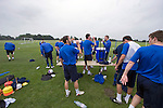 Stockport Pre-Season Training, 09/07/2008. Manor Farm, Timperley, League One. Stockport County players taking drinks during a pre-season training session at the club's training ground at Manor Farm, Timperley, Cheshire. Stockport County were promoted up to league One following a play-off final victory over Rochdale at Wembley in May, 2008. Jim Gannon took over as manager of the club in 2006 and lead them to promotion after three seasons in League Two. Photo by Colin McPherson.