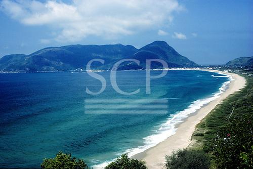 Ilha de Sta Catarina, Brazil. Morro das Pedras, Armacao; long, curving sandy beach with granite hills.