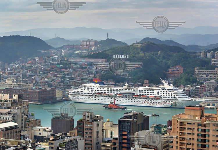 A cruise ship in the port on a rare sunny day in the port city of Keelung in north Taiwan, known as Taiwan's 'Rainy City'.
