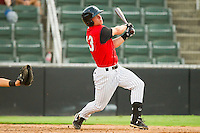 Collin Kuhn #13 of the Kannapolis Intimidators follows through on his swing against the Asheville Tourists at Fieldcrest Cannon Stadium on July 28, 2011 in Kannapolis, North Carolina.  The Intimidators defeated the Tourists 2-1 in 10 innings.   (Brian Westerholt / Four Seam Images)
