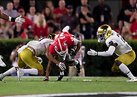 ATHENS, GA - SEPTEMBER 21: Demetris Robertson #16 of the Georgia Bulldogs catches a pass against Notre Dame during a game between Notre Dame Fighting Irish and University of Georgia Bulldogs at Sanford Stadium on September 21, 2019 in Athens, Georgia.