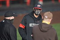 Western Kentucky Hilltoppers head coach John Pawlowski meets with Valparaiso Crusaders head coach Brian Schmack and home plate umpire Todd Mullins prior to their NCAA baseball game at Nick Denes Field on March 19, 2021 in Bowling Green, Kentucky. (Brian Westerholt/Four Seam Images)
