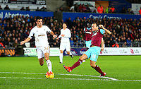 Mark Noble of West Ham United has a shot on goal during the Barclays Premier League match between Swansea City and West Ham United played at The Liberty Stadium, Swansea on 20th December 2015