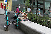 Disabled man with a wheelchair sleeping rough, Budapest.