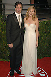 Jon Hamm & Jennifer Westfeldt attends The 2010 Vanity Fair Oscar Party held at The Sunset Tower Hotel in West Hollywood, California on March 07,2010                                                                                       © 2010 DVS / RockinExposures..