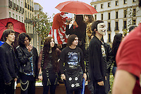 """Spain. Province of Madrid. Madrid. A group of young people celebrate the """"Feliz Dia  Frikis"""". May 25th is the International Freak Pride's Day. The word freak when used in a slang context also has positive connotations. It can be used to describe one who denotes a strong fondness or even obsession with a particular activity, like a passion for Star wars and wearing dark clothes. Downtown. Town center. Santo Domingo place. Carnical mask. © 2007  Didier Ruef."""