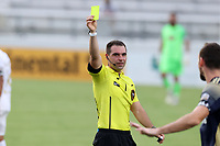 CARY, NC - AUGUST 01: Kevin Broadley shows the yellow card during a game between Birmingham Legion FC and North Carolina FC at Sahlen's Stadium at WakeMed Soccer Park on August 01, 2020 in Cary, North Carolina.
