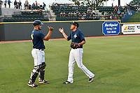 Starting pitcher Justin Brantley (4) of the Columbia Fireflies slaps hands with catcher Brandon Brosher before game two of a doubleheader against the Rome Braves on Saturday, August 19, 2017, at Spirit Communications Park in Columbia, South Carolina. Columbia won, 1-0. (Tom Priddy/Four Seam Images)