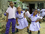 Children at an early childhood learning center in Jamaica pose during a recess break. (DOUG WOJCIK MEDIA)