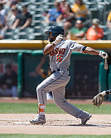 Teoscar Hernandez (15) of the Fresno Grizzlies follows through on his swing against the Salt Lake Bees during the Pacific Coast League game at Smith's Ballpark on April 16, 2017 in Salt Lake City, Utah. Salt Lake defeated Fresno 5-4. (Stephen Smith/Four Seam Images)
