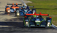 19 March 2011: The #063 Oreca FLM09 of Eric Lux, Elton Julian, and Christian Zugel leads a pack of cars during the 12 Hours of Sebring, Sebring Internatonal Raceway, Sebring, FL. (Photo by Brian Cleary/www.bcpix.com)