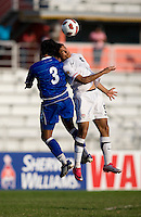 Mario Rodriguez (9) of the United States goes up for a header with  Victorino Zelaya (3) of El Salvador during the quarterfinals of the CONCACAF Men's Under 17 Championship at Catherine Hall Stadium in Montego Bay, Jamaica. The USA defeated El Salvador, 3-2, in overtime.