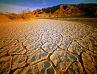 Dried mud patterns and Paniment Mountains. Death Valley National Park, California