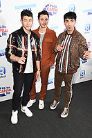 LONDON, UK. June 08, 2019: Jonas Brothers poses on the media line before performing at the Summertime Ball 2019 at Wembley Arena, London<br /> Picture: Steve Vas/Featureflash