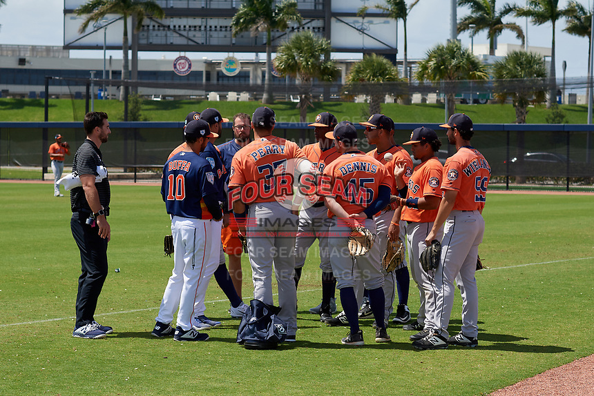 Houston Astros coaches Ozney Guillen and Jacob Buffa talk with the team before a Minor League Spring Training Intrasquad game on March 28, 2019 at the FITTEAM Ballpark of the Palm Beaches in West Palm Beach, Florida.  (Mike Janes/Four Seam Images)