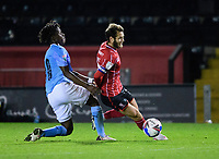 Lincoln City's Jorge Grant is fouled by Manchester City U21's Romeo Lavia<br /> <br /> Photographer Chris Vaughan/CameraSport<br /> <br /> EFL Papa John's Trophy - Northern Section - Group E - Lincoln City v Manchester City U21 - Tuesday 17th November 2020 - LNER Stadium - Lincoln<br />  <br /> World Copyright © 2020 CameraSport. All rights reserved. 43 Linden Ave. Countesthorpe. Leicester. England. LE8 5PG - Tel: +44 (0) 116 277 4147 - admin@camerasport.com - www.camerasport.com