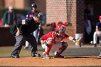 Belmont Abbey Crusaders catcher Drew Sipp (5) waits for the baseball during the game against the Shippensburg Raiders at Abbey Yard on February 8, 2015 in Belmont, North Carolina.  The Raiders defeated the Crusaders 14-0.  (Brian Westerholt/Four Seam Images)