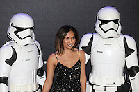 Mylene Klass poses with Stormtroopers during the STAR WARS: 'The Force Awakens' EUROPEAN PREMIERE at Odeon, Empire & Vue Cinemas, Leicester Square, England on 16 December 2015. Photo by David Horn / PRiME Media Images