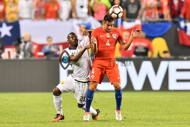 Chile defender Mauricio Isla (4) and Colombia forward Marlos Moreno (21) vying for the ball during Copa America Centenario semifinal match, Wednesday, June 22, 2016 in Chicago, Illi. Chile won 2-0. (TFV Media via AP) *Mandatory Credit*