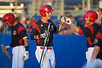Batavia Muckdogs designated hitter Branden Berry (35) fist bumps Mike Garzillo (11) after hitting a home run during a game against the Hudson Valley Renegades on August 2, 2016 at Dwyer Stadium in Batavia, New York.  Batavia defeated Hudson Valley 2-1. (Mike Janes/Four Seam Images)