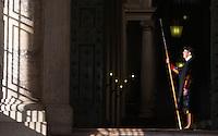 Una Guardia Svizzera al Portone di Bronzo di Piazza San Pietro, Citta' del Vaticano, 19 novembre 2015.<br /> A Swiss Guard stands on in front of the Bronze Door, in St. Peter's Square, at the Vatican, 19 November 2015.<br /> UPDATE IMAGES PRESS/Riccardo De Luca<br /> <br /> STRICTLY ONLY FOR EDITORIAL USE