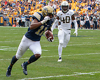 Pitt wide receiver Taysir Mack (11) makes a 60-yard reception and run while being pursued by Georgia Tech defensive back Kaleb Oliver (40). The Pitt Panthers football team defeated the Georgia Tech Yellow Jackets 24-19 on September 15, 2018 at Heinz Field in Pittsburgh, Pennsylvania.