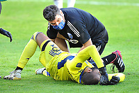 WASHINGTON, DC - NOVEMBER 8: Clement Diop #23 of Montreal Impact gets attended by team staff after a hard tackle during a game between Montreal Impact and D.C. United at Audi Field on November 8, 2020 in Washington, DC.