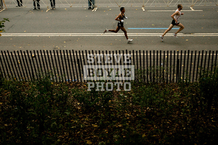 Khalid Khannouchi (left) and Jason Lehmkuhle run through Central Park while competing in the 2008 Men's Olympic Trials Marathon on November 3, 2007 in New York, New York.  The race began at 50th Street and Fifth Avenue and finished in Central Park.  Hall won the race with a time of 2:09:02.