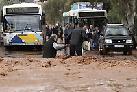 Pictured: Locals walk through the flood.<br /> Re: Five people have reportedly died and severe damage caused by heavy rain and flash flooding in the area of Mandra, near Athens, Greece. Wednesday 15 November 2017