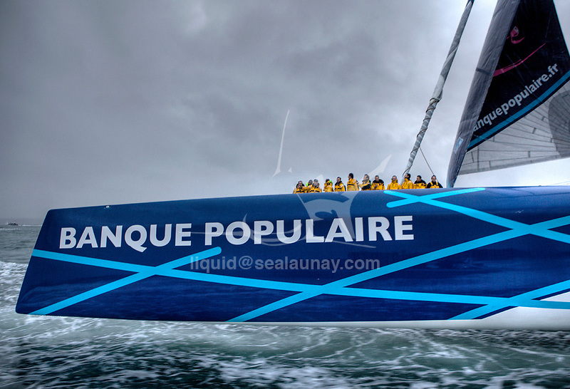 Maxi Banque Populaire V (FRA), the 140 foot trimaran skippered by Loick Peyron on her arrival from her new TrophÈe Jules Verne record, 45 days 13 hours 42 minutes 53 secondes, Brest, Brittany, France.