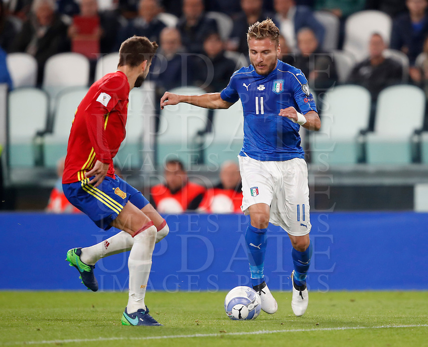 Italy Ciro Immobile, right, is challenged by Spain Gerard Pique' during the Fifa World Cup 2018 qualification soccer match between Italy and Spain at Turin's Juventus Stadium, October 6, 2016. The game ended 1-1.<br /> UPDATE IMAGES PRESS/Isabella Bonotto