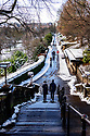 People go for their daily walk in Princes Street gardens, after Edinburgh gets its first dusting of snow in the first Covid Winter. Edinburgh has been placed in Tier 4 restrictions due to the Covid-19 pandemic.