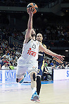 Real Madrid's Sergio Llull (l) and Alba Berlin's Alex King during Euroleague match.March 12,2015. (ALTERPHOTOS/Acero)