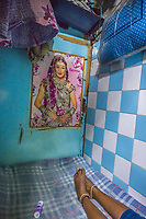 India, Maharashtra, Mumbai, Bombay, red light district. A sex-worker in her room, that consists of only a bed.