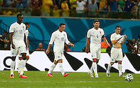 England players show a look of dejection after Claudio Marchisio of Italy scores a goal to make the score 1-0