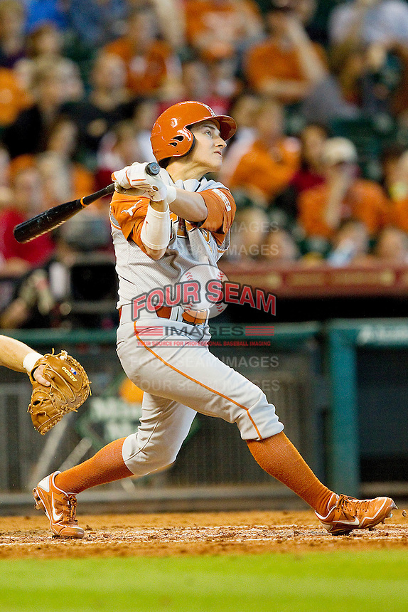 Mark Payton #2 of the Texas Longhorns follows through on his swing against the Tennessee Volunteers at Minute Maid Park on March 3, 2012 in Houston, Texas.  The Volunteers defeated the Longhorns 5-4.  (Brian Westerholt/Four Seam Images)