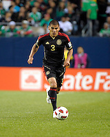 Mexico's Carlos Salcido dribbles the ball.  Mexico defeated Costa Rica 4-1 at the 2011 CONCACAF Gold Cup at Soldier Field in Chicago, IL on June 12, 2011.