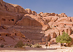 The amphitheater at Petra was hand carved by the Nabateans from the rock -- in places cutting through the caves cut by previous generations.  © Rick Collier