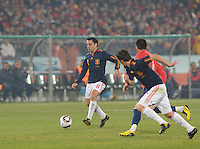 Xavi looks to supply ball to David Villa's run. Spain won Group H following a 2-1 defeat of Chile in Pretoria's Loftus Versfeld Stadium, Friday, June 25th, at the 2010 FIFA World Cup in South Africa..