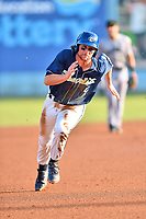 Asheville Tourists shortstop Ryan Vilade (4) runs to third base during a game against the Augusta GreenJackets at McCormick Field on August 18, 2018 in Asheville, North Carolina. The Tourists defeated the GreenJackets 14-3. (Tony Farlow/Four Seam Images)