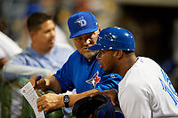 Dunedin Blue Jays pitching coach Jim Czajkowski (left) talks with manager Cesar Martin (16) during a Florida State League game against the Clearwater Threshers on April 4, 2019 at Spectrum Field in Clearwater, Florida.  Dunedin defeated Clearwater 11-1.  (Mike Janes/Four Seam Images)