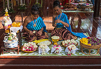 Traditional dressed Thai Girls preparing flowers, Phra Nakhon Si Ayutthaya