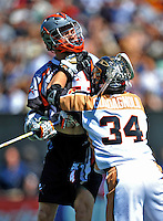 24 August 2008: Denver Outlaws' Midfielder Josh Sims (4) is checked by Rochester Rattlers' Defenseman Kyle Guadagnolo during the Championship Game of the Major League Lacrosse Championship Weekend at Harvard Stadium in Boston, MA. The Rattles took control of the second half to defeat the Outlaws 16-6 and take the league honor for the 2008 season...Mandatory Photo Credit: Ed Wolfstein Photo