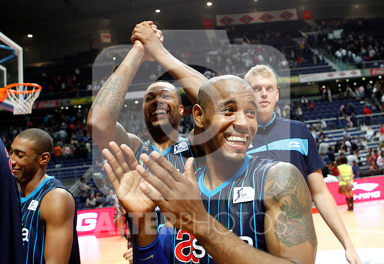 Asefa Estudiantes' Luis Flores (r) and Antoine Wright celebrate the victory during Liga Endesa ACB match.October 22,2011. (ALTERPHOTOS/Acero)