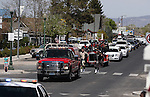 Residents line Main Street to watch the funeral procession for former Nevada Assembly Speaker Joe Dini on Tuesday, April 15, 2014, in Yerington, Nev. (Las Vegas Review-Journal/Cathleen Allison)