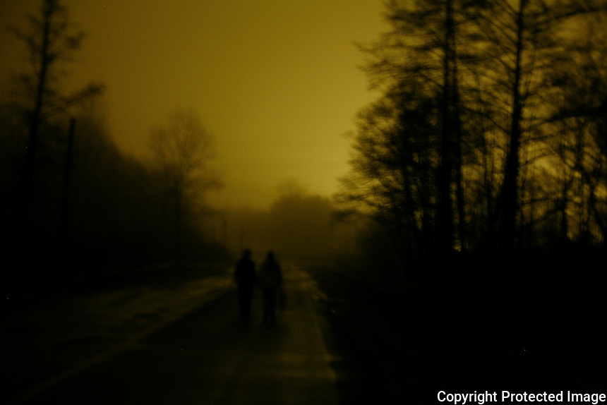 """Nina Dubrovskaya and Lena Priyenko walk home to their village from Ivankiv, Ukraine, 2 miles away. The women, both divorcees, went out in search of company, but found all 4 bars empty. """"When the money gets short, people just get drunk at home,"""" says Dubrovskaya.  <br /> ------------------- <br /> This photograph is part of Michael Forster Rothbart's After Chernobyl documentary photography project.<br /> © Michael Forster Rothbart 2007-2010.<br /> www.afterchernobyl.com<br /> www.mfrphoto.com <br /> 607-267-4893 o 607-432-5984<br /> 5 Draper St, Oneonta, NY 13820<br /> 86 Three Mile Pond Rd, Vassalboro, ME 04989<br /> info@mfrphoto.com<br /> Photo by: Michael Forster Rothbart<br /> Date:  1/2009    File#:  Canon 5D digital camera frame 3114<br /> ------------------- <br /> Original caption: .Late on a long winter's night, Nina Dubrovskaya and her friend Lena Priyenko walk home to their village Sukachi, Ukraine, from the nearby town of Ivankiv, 2 miles away. The two women, both divorcees, went out to the bars in Ivankiv in search of company, but found all 4 bars they visited nearly empty. """"When the money gets short, people just get drunk at home,"""" says Dubrovskaya. ."""
