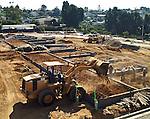 Bulldozer moves dirt in new housing contruction.